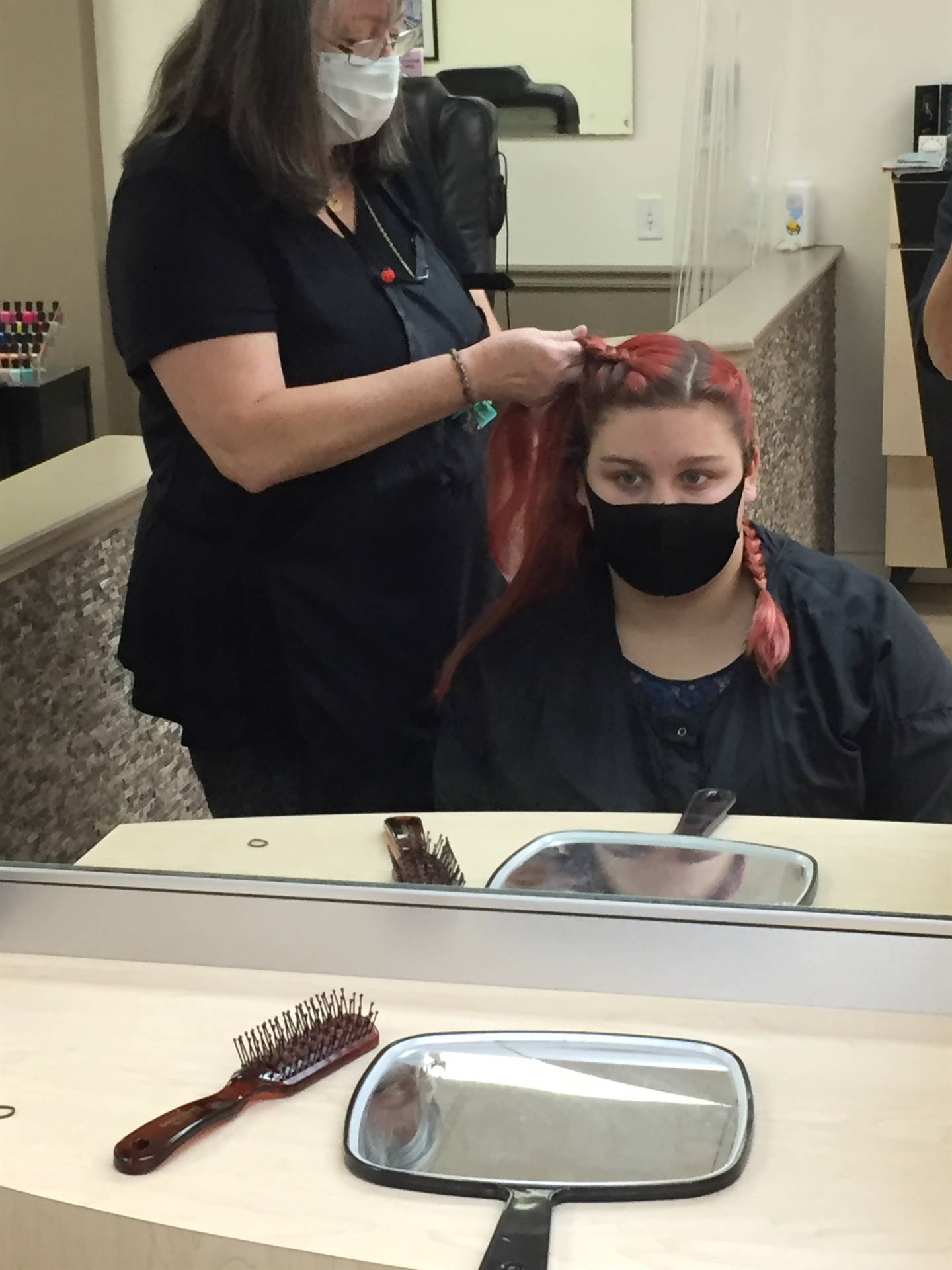 Job training student pictured getting her hair done at Marci's Hair on the Square in Chardon