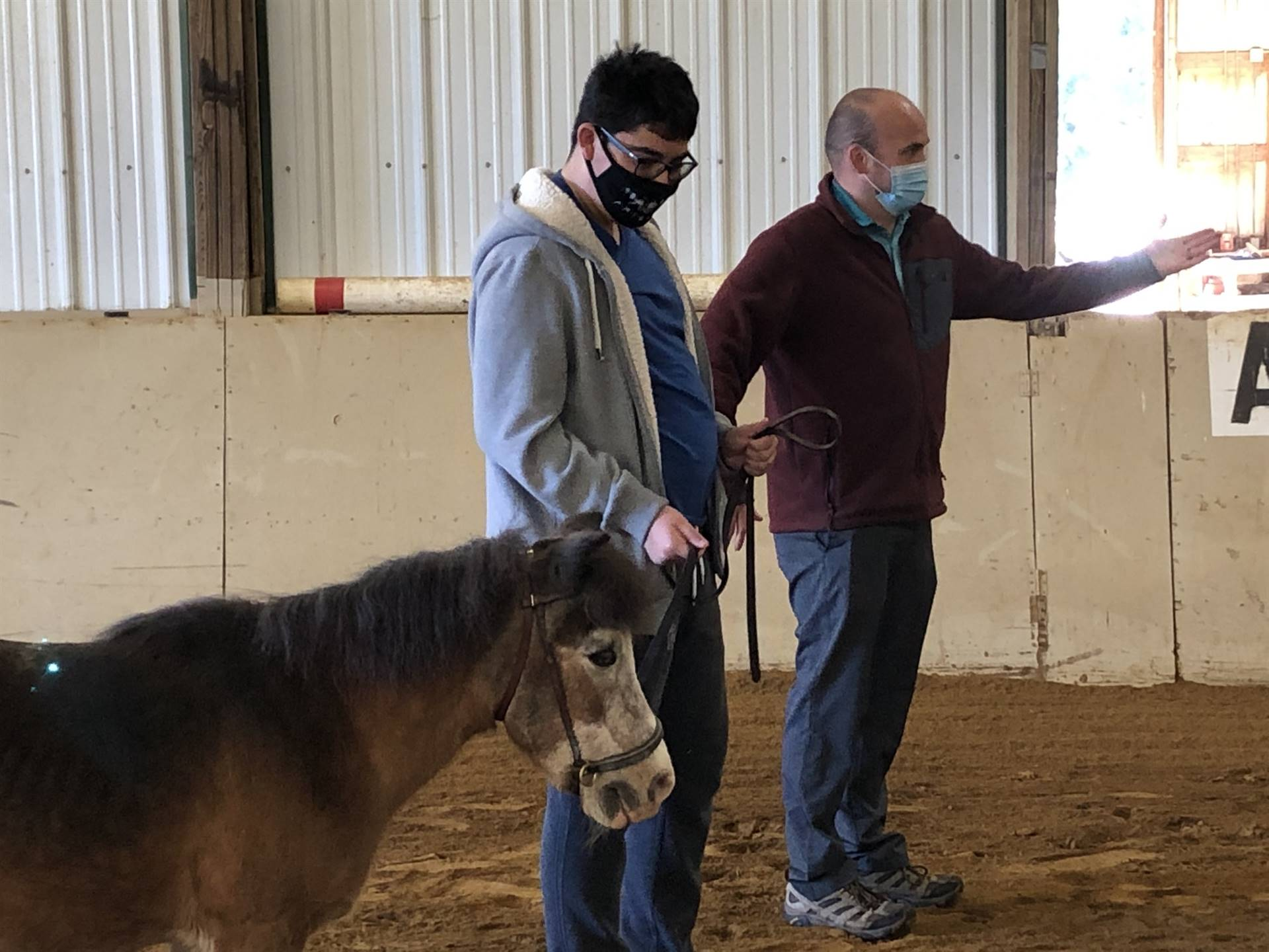 Student pictured practicing skills at side walking the horses during Equine Partnerships class!