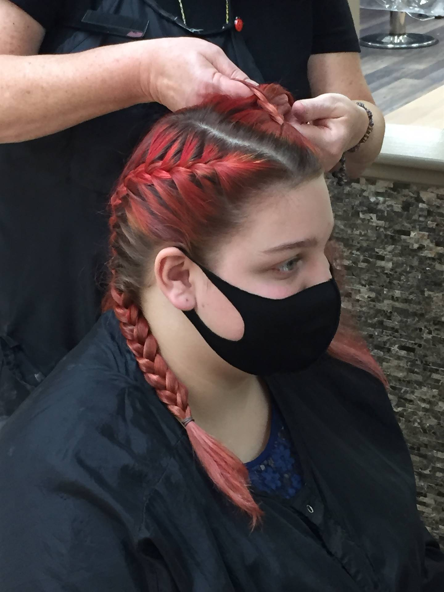 Job Training Student pictured getting her hair done at Marci's Hair on the Square!