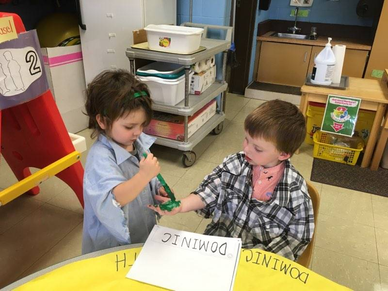 Students writing their name