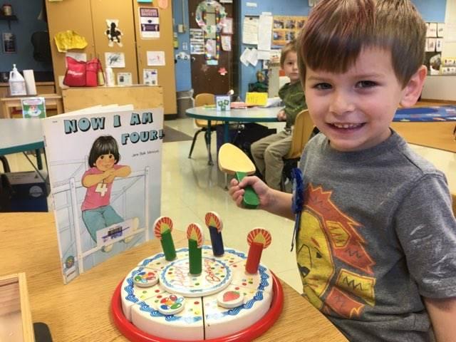 Student cutting a play birthday cake