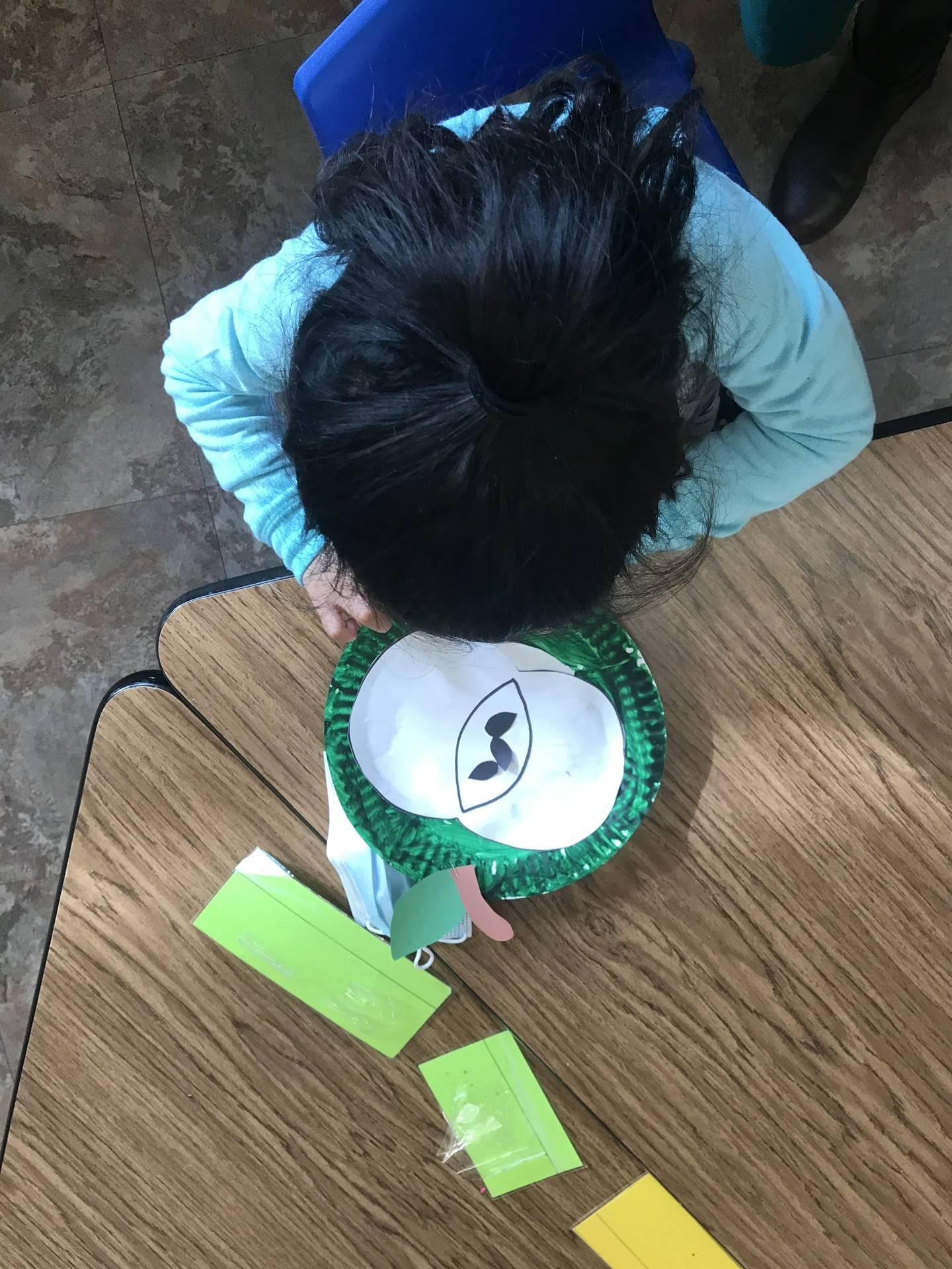 Preschool student working on apple activity