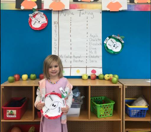 Preschool Student pictured with fun apple activity from the Great Lakes Great Apple Crunch Week!