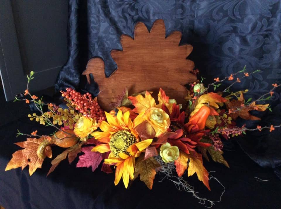 Wooden Turkey decor arrangement with fall flowers