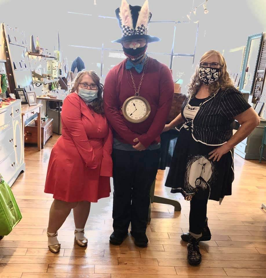 Unique Like Me students pictured with their store manager ready for Halloween!