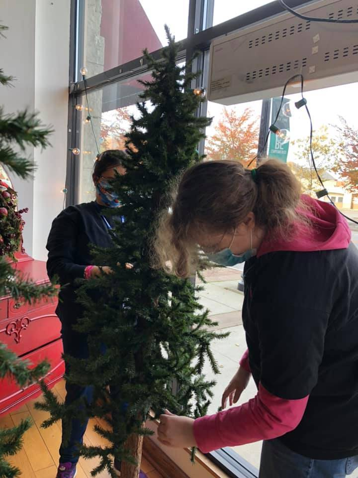 Our students are getting the store ready for the holiday season!