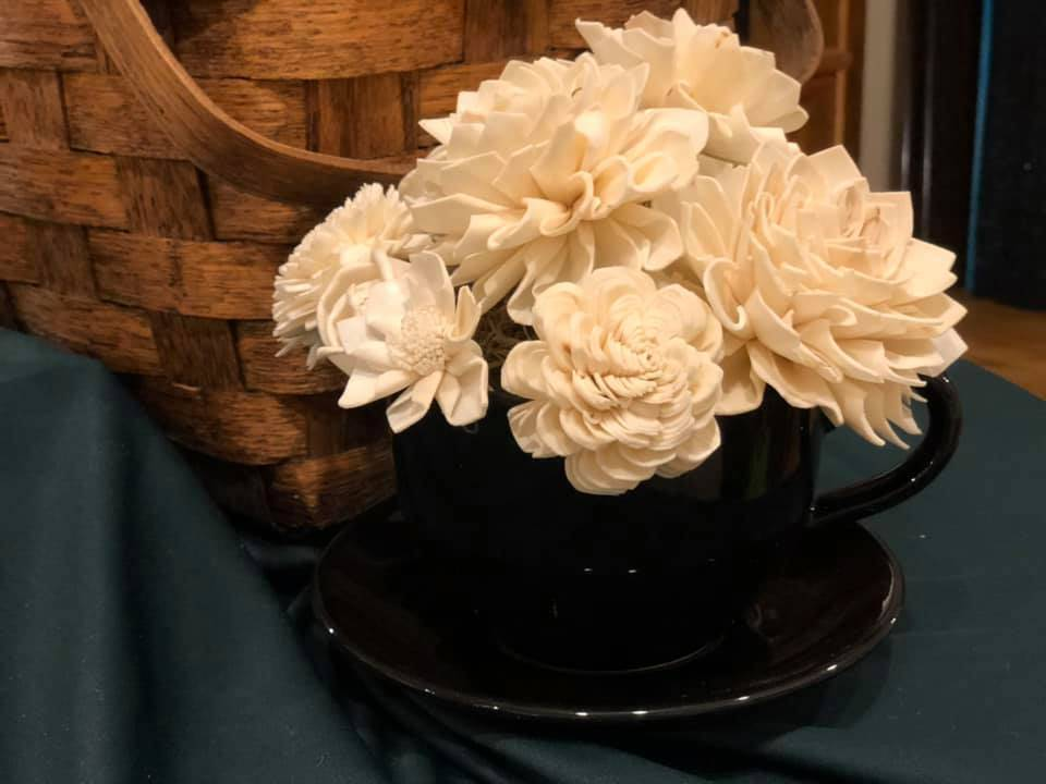 These beautiful flowers are made of wood! Stop by our store and check them out!
