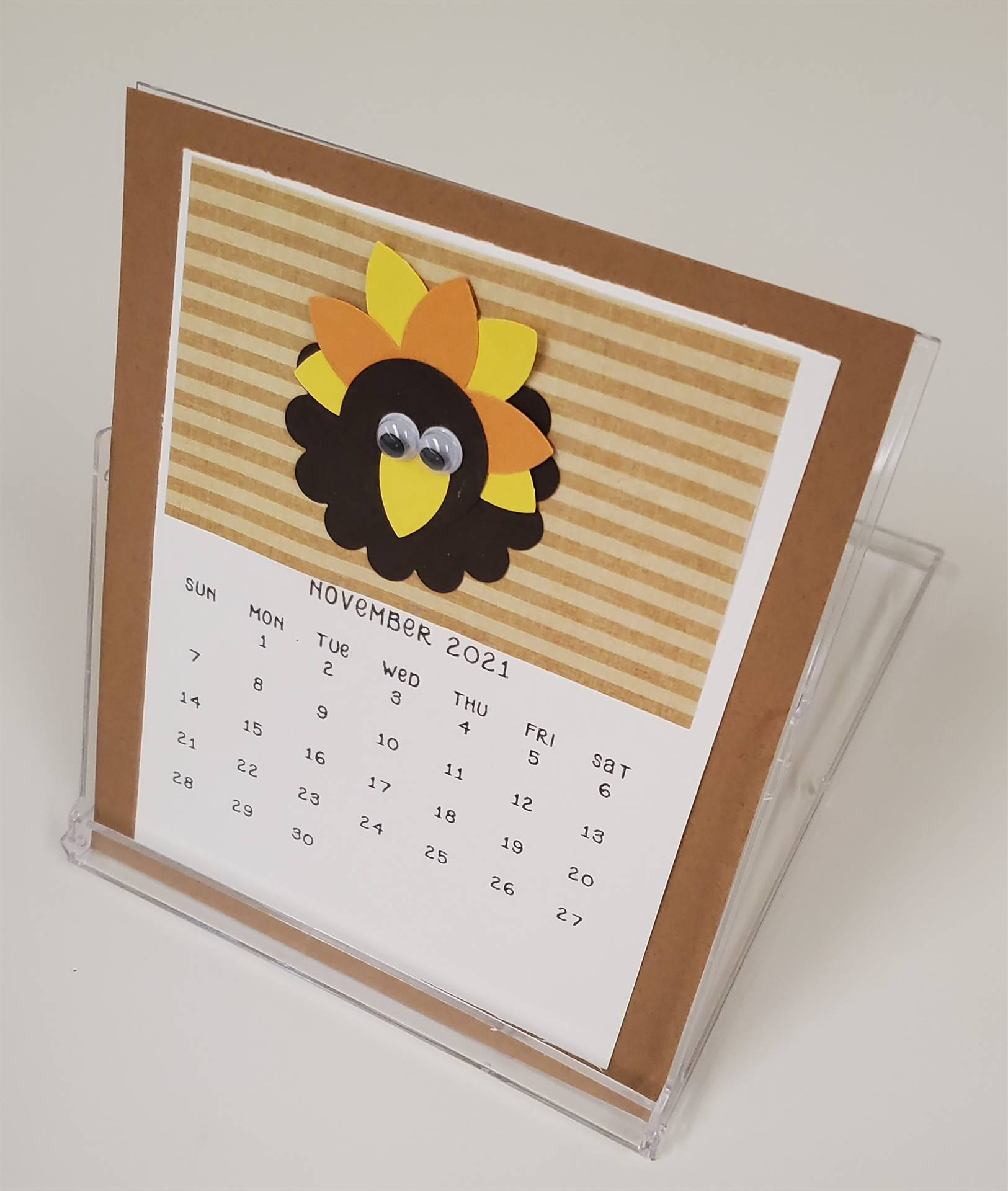 The calendars come with a display case, so that they can sit nicely on your desk!