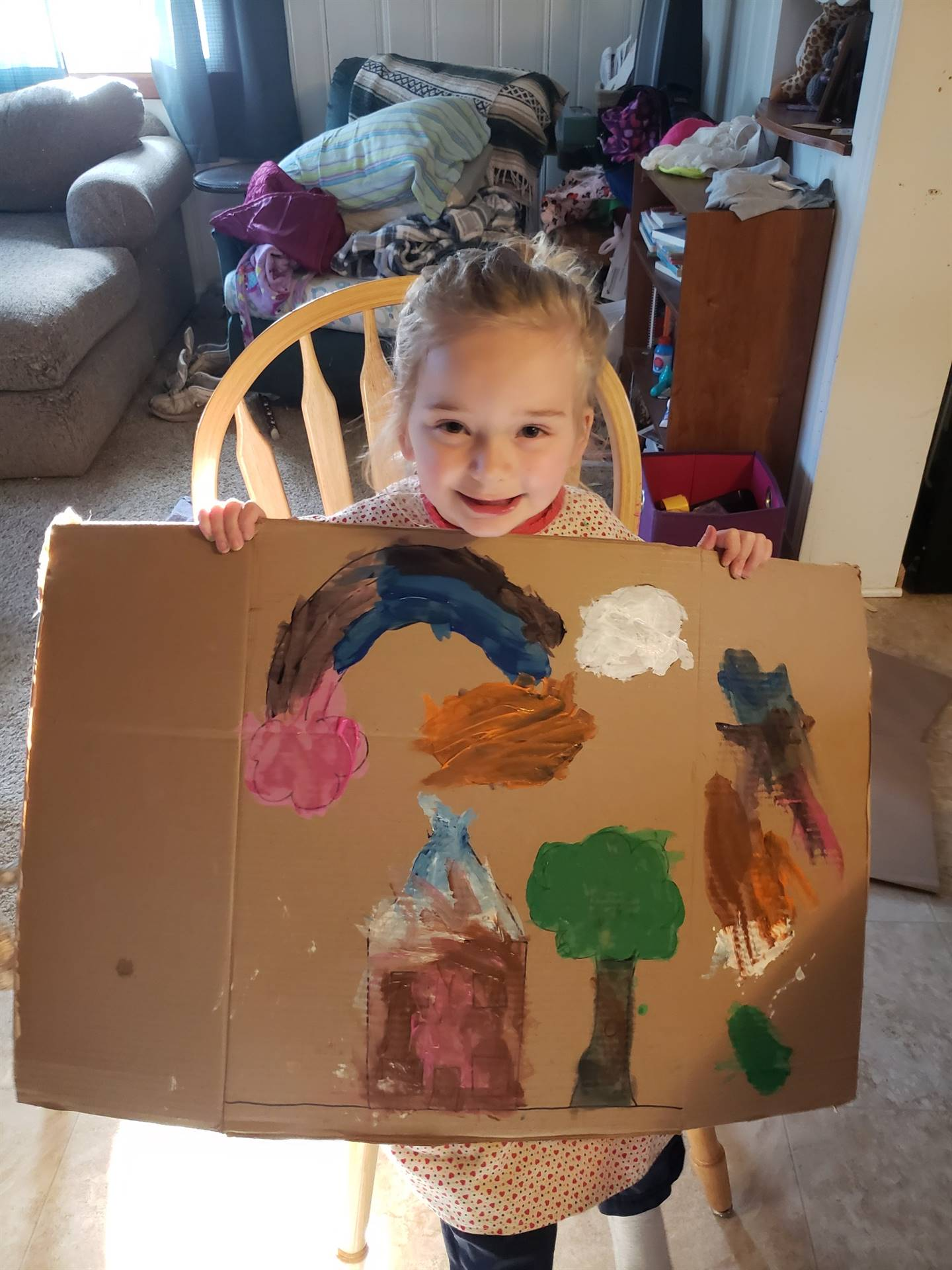 Student painted a picture on a big piece of cardboard