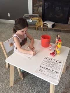 Student from Mrs. Robinson's preschool class is working on a letter sheet from home.