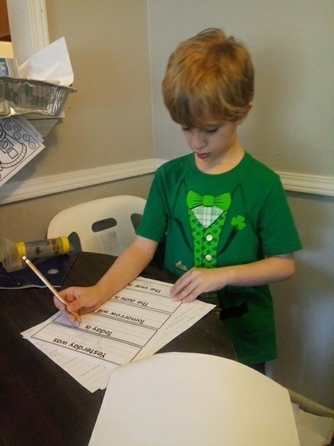 ACHIEVE student from Lindsey Elementary completing his school work at home.