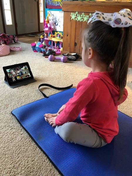 Child doing yoga virtually