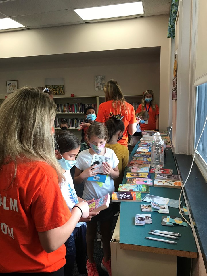 Page Tuners program volunteers assisted students with choosing a free book to take home to inspire them to read for enjoyment!