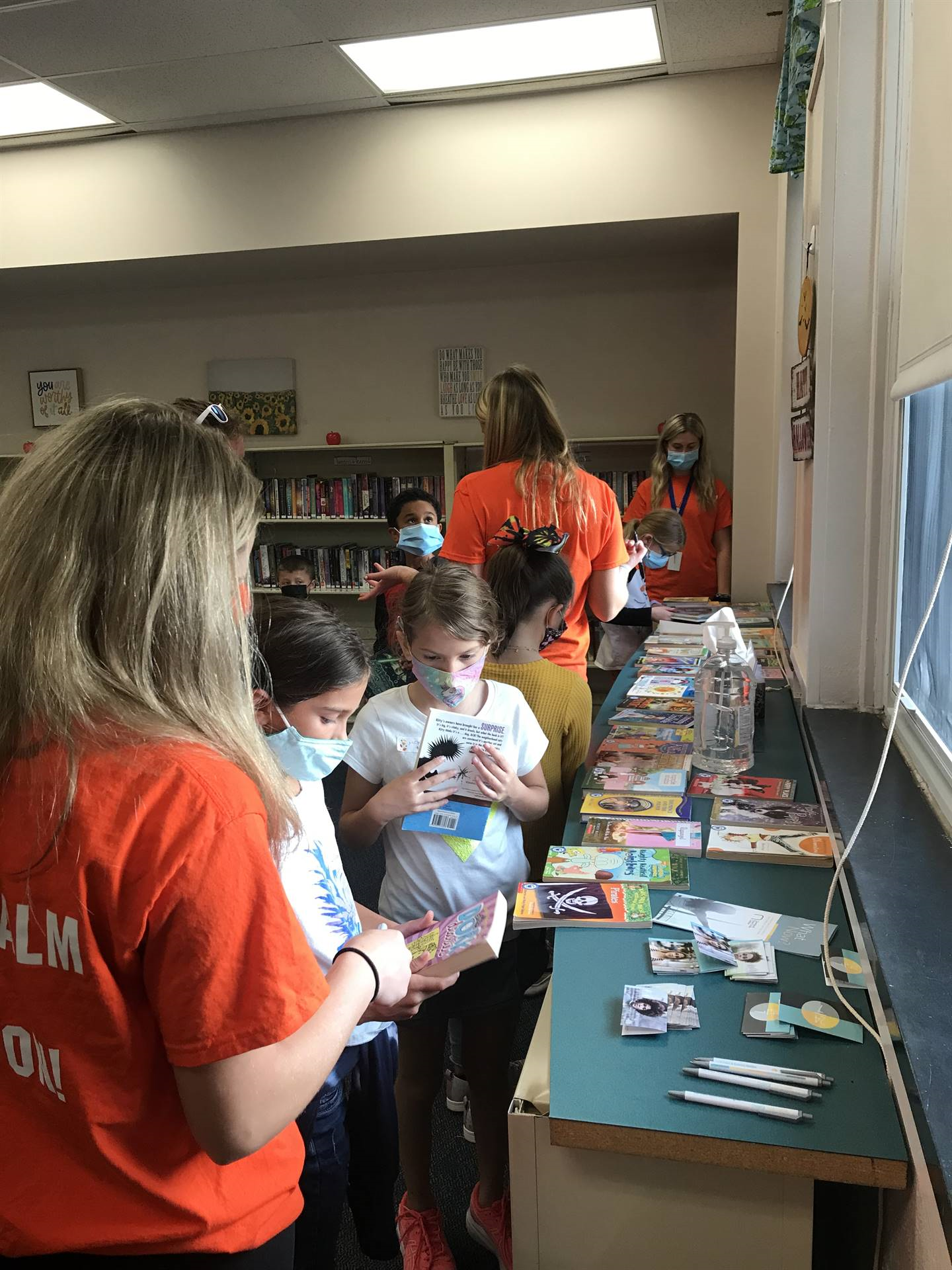 Page Tuners volunteers assisted students with choosing a free book to take home to inspire them to r