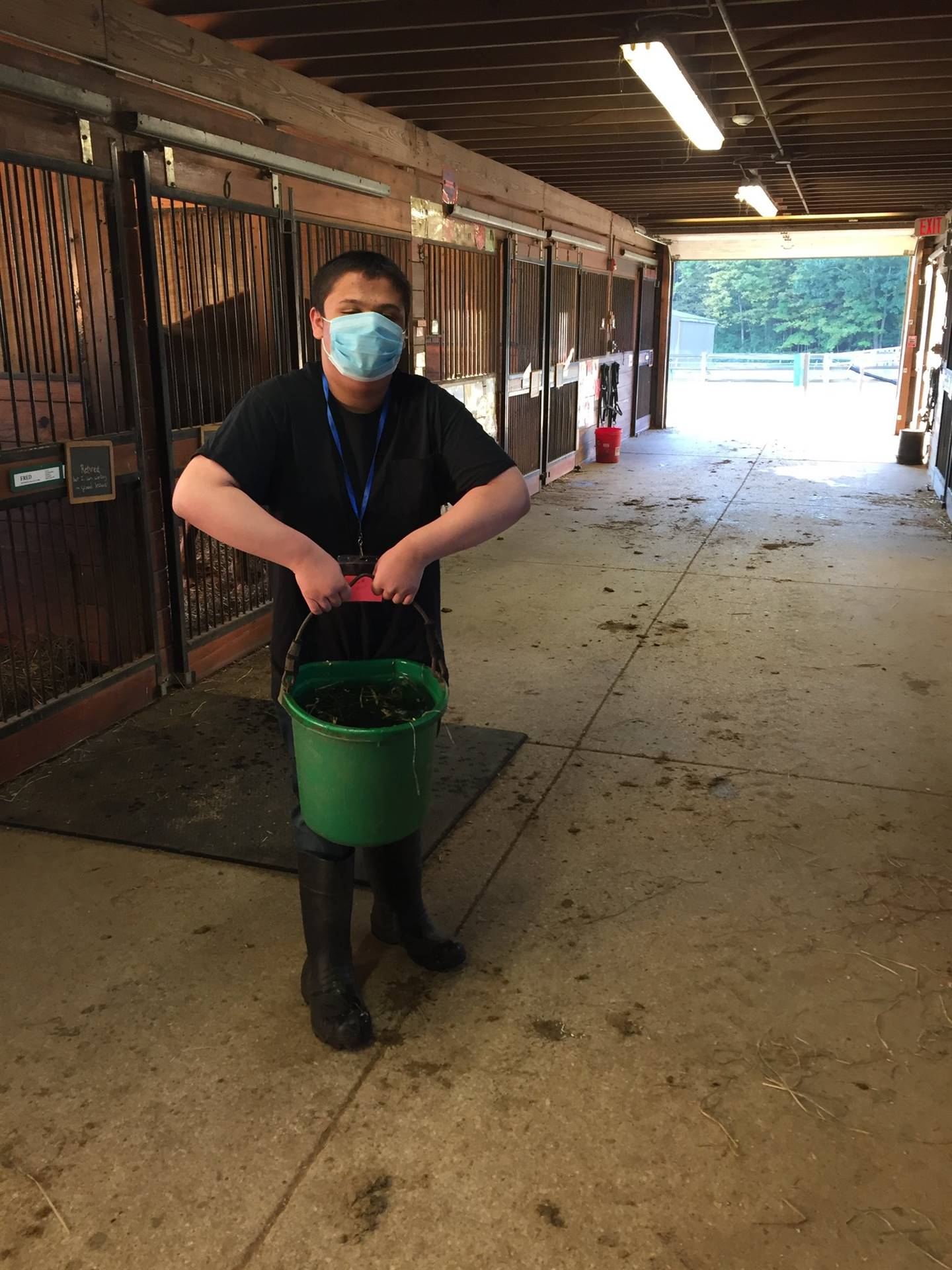 Students work in the barn each morning changing water buckets and completing light barn tasks
