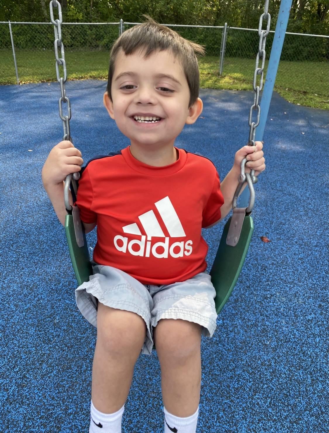 Child swinging outside