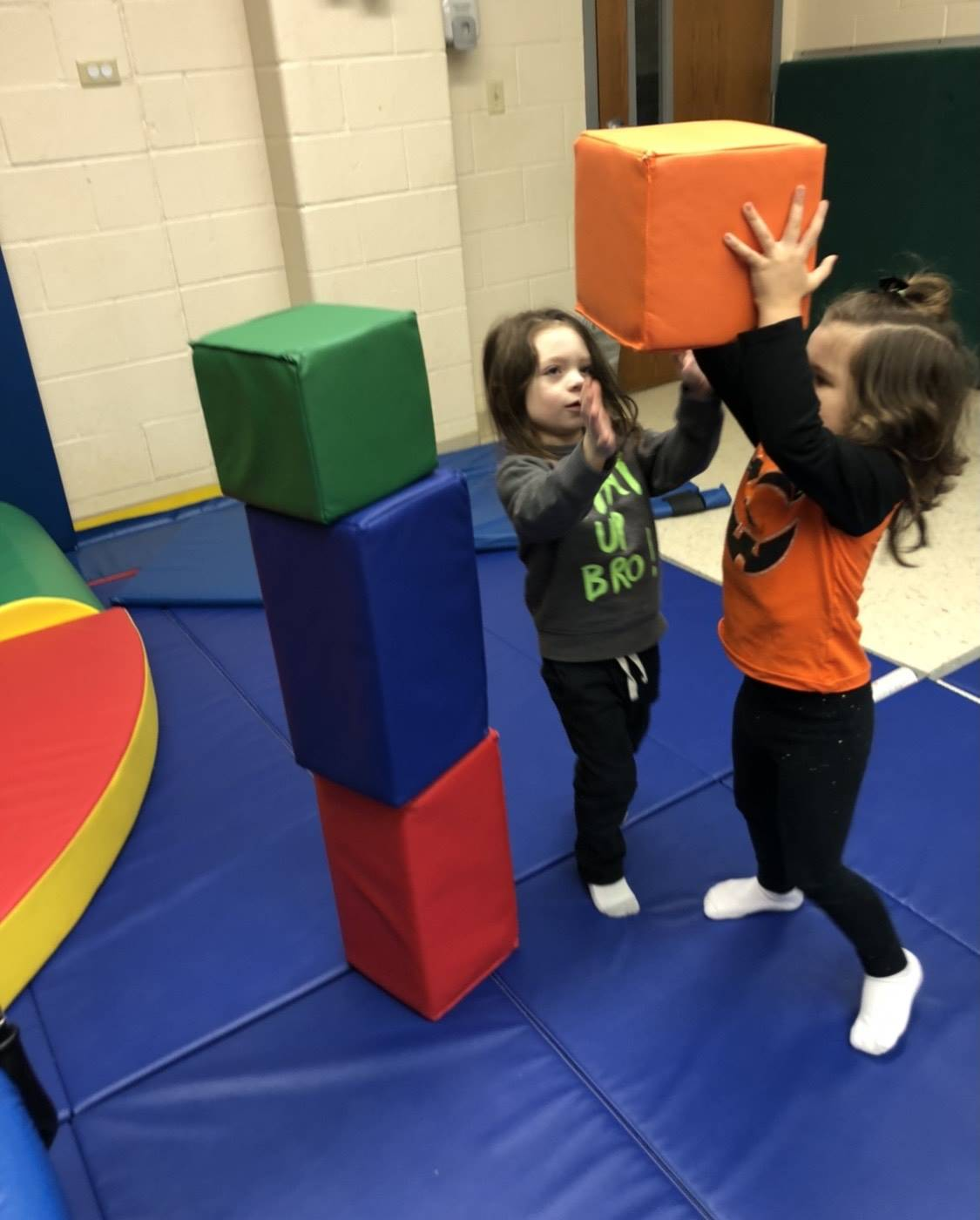 students building with foam blocks