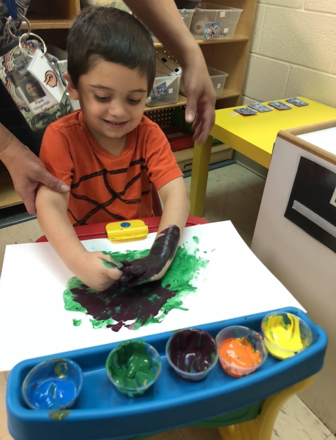 child using finger paint