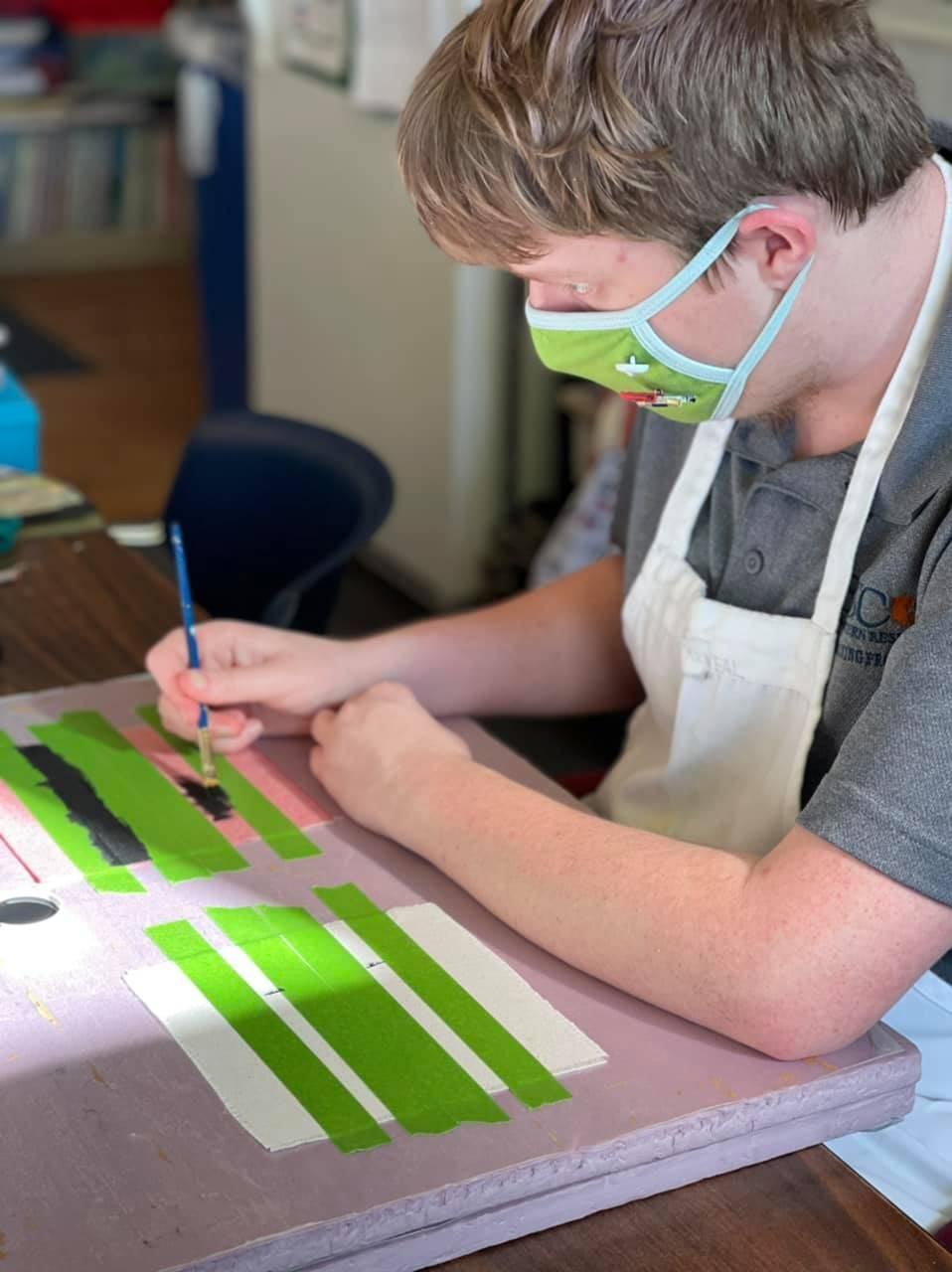 Student working on making a tic tac toe set