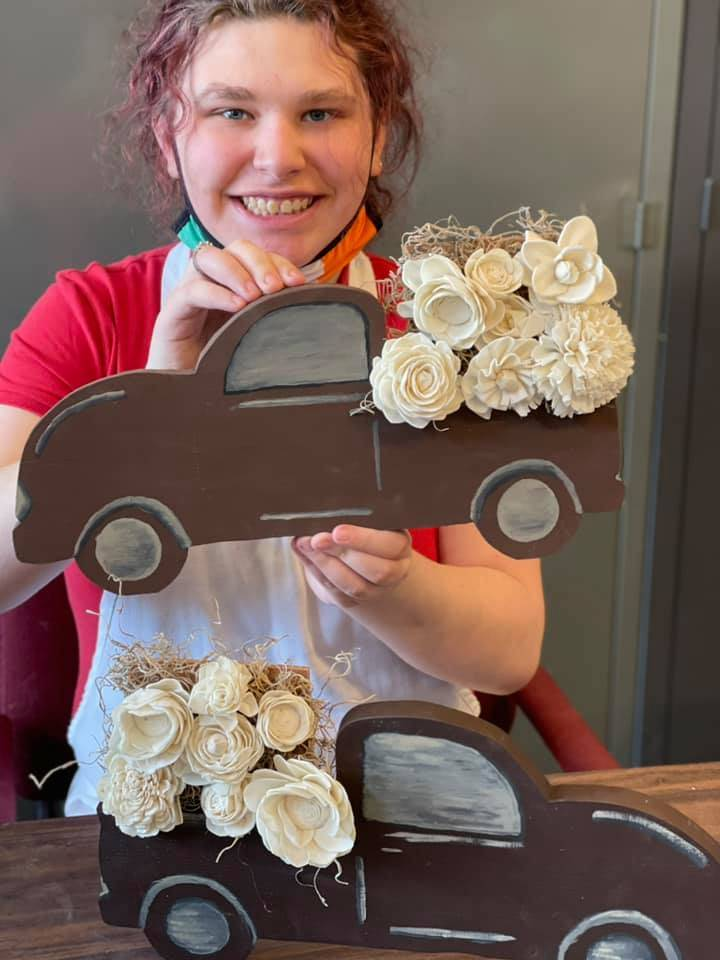 student pictured with rustic truck decoration