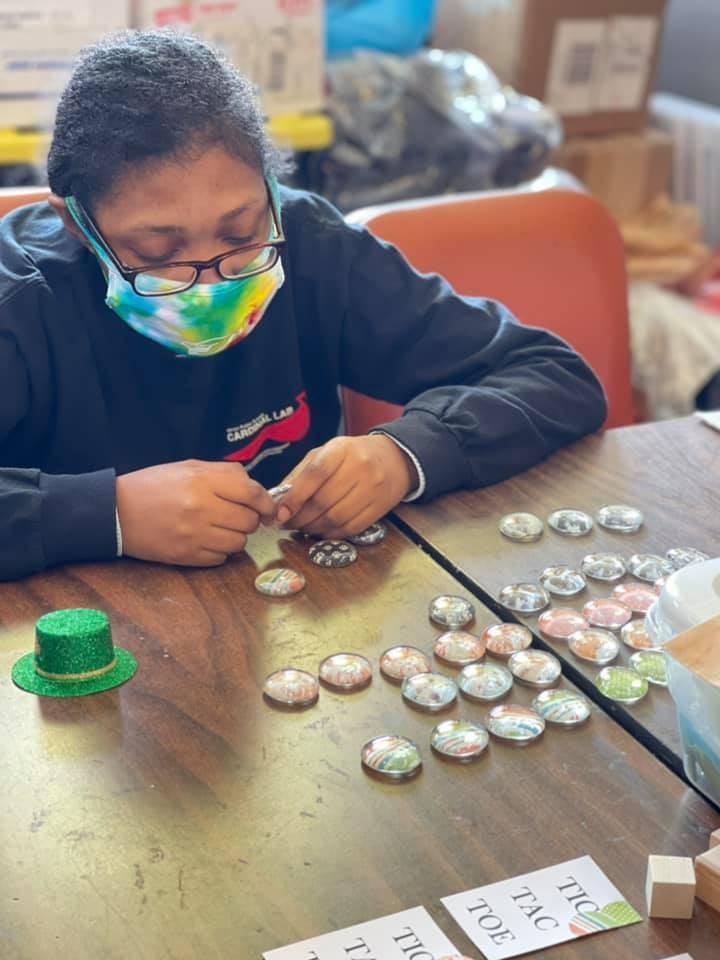 Student working on tic tac toe set