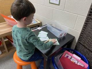 preschooler working on number recognition