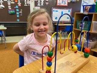preschool student playing during free choice