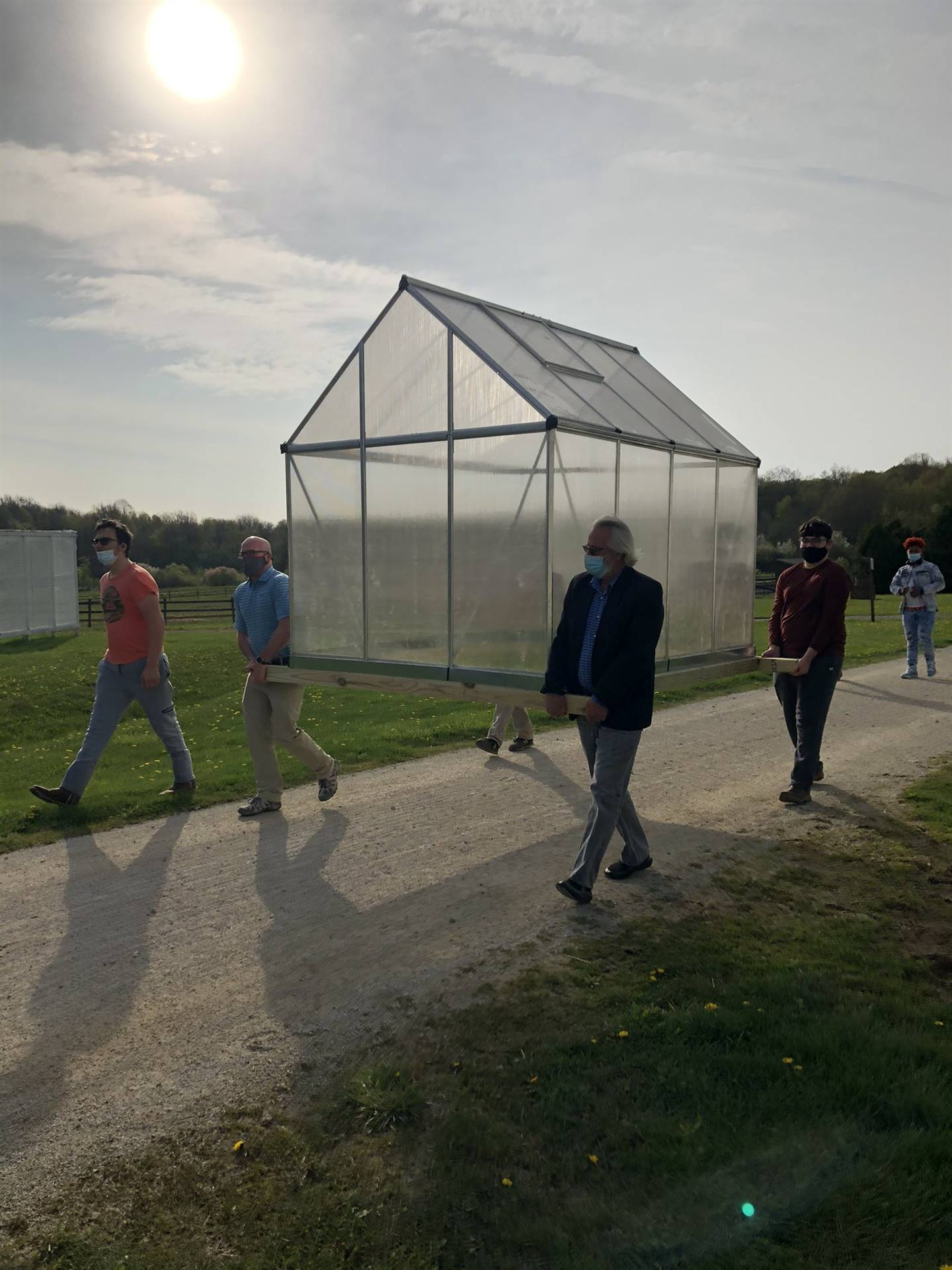 Gaitway High School Students were happy to move the new Greenhouse before all the rain!
