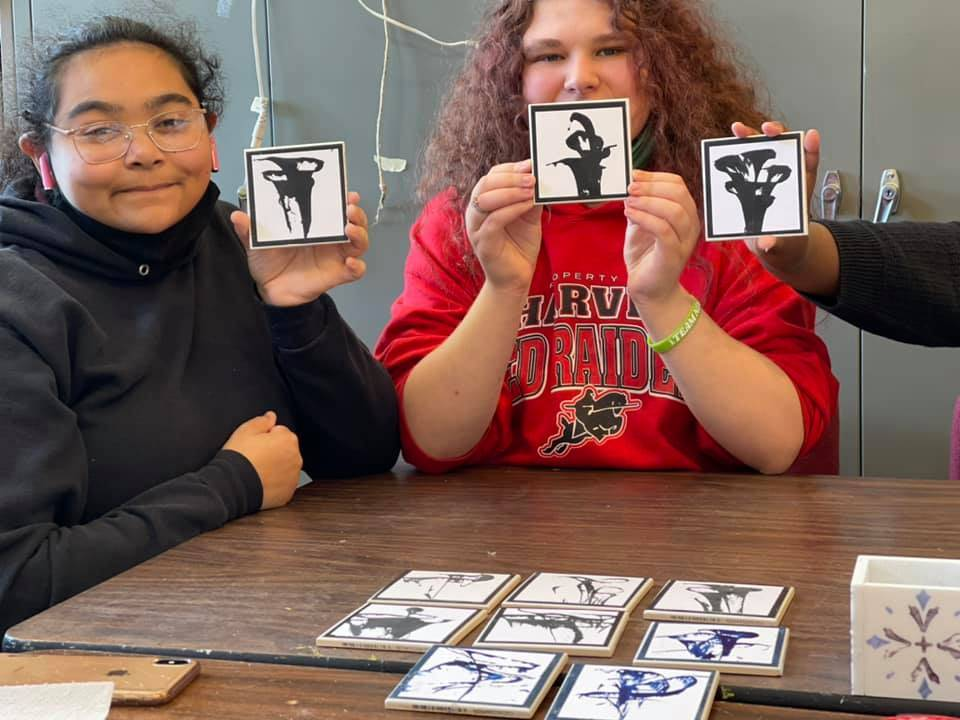 Unique Like Me Students pictured with coasters