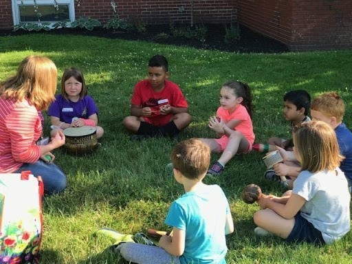 Summer Side Kick students spent time with Miss Kim from Family Pride learning about instruments from around the world during Arts & Culture week.