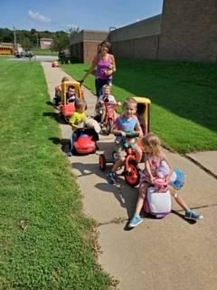 Preschoolers parading their teddy bears around during their teddy bear picnic